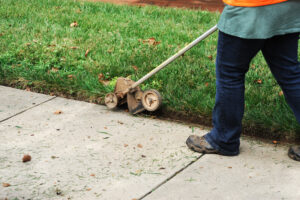 Person using a lawn edging tool