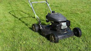 Lawn mower on long grass