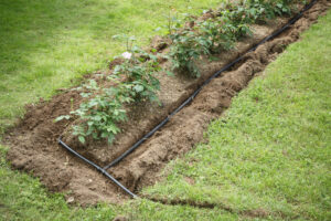 Drip hose system installed into flowerbed